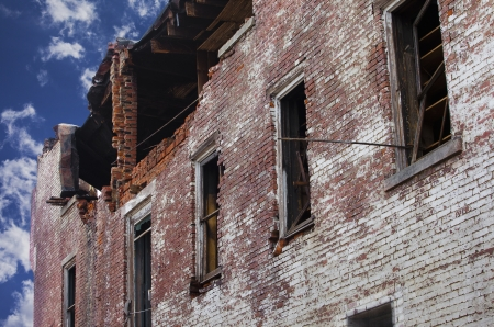 vandalize: A brick building that has been damaged by fire