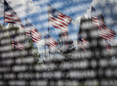 American memorial, the reflection of American Flags in an engraved memorial