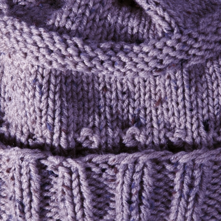 Close up of handmade knit hat made of purple yarn photo