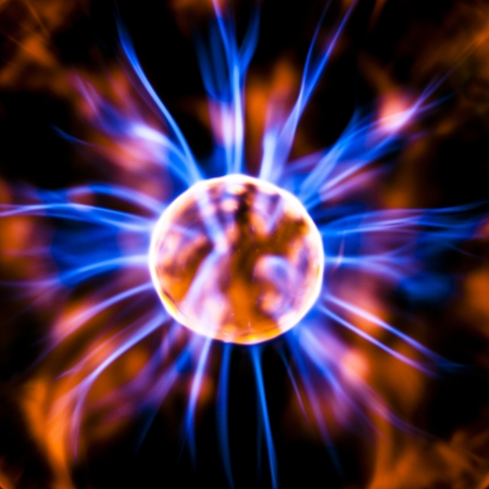electrode: The middle of a plasma orb radiates colored light currents Stock Photo