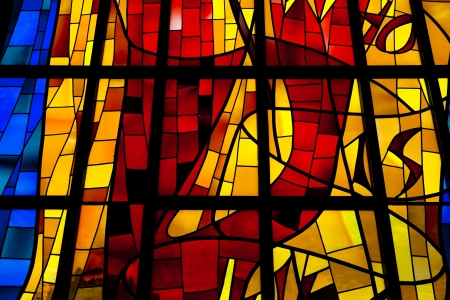 vividly: A bright and brilliant, vividly colored stained glass window