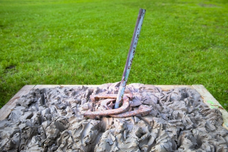Clay horseshoe pitching pit for tournament with double ringer
