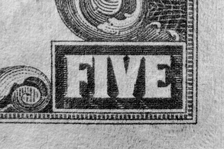 five dollars: The word five on US currency 5 dollar bill