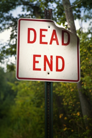 Bold red dead end sign marks the end of the road