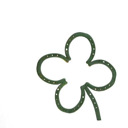 four leafed clover: A green four leafed clover decoration made out of horseshoes