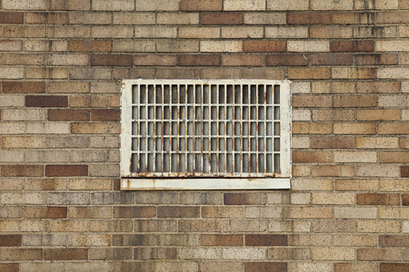 staining: Vent on brick building, building restoration issues, black deposits, staining, and rust
