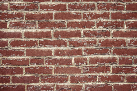 the deposits: Red clay brick wall with white deposits and mortar smears, new construction cleaning issues Stock Photo