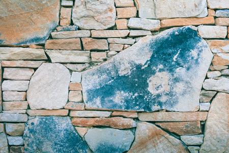 irregular: Detail of irregular stacked natural stone wall no mortar