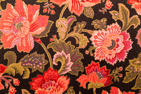 Vibrant, fancy, ornate, floral design on fabric textile. Stock Photo