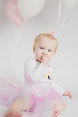 one year old: One year old girl birthday portraits with balloons