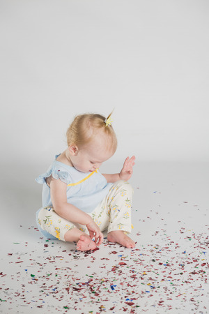 one year old: One year old girl birthday portraits with confetti
