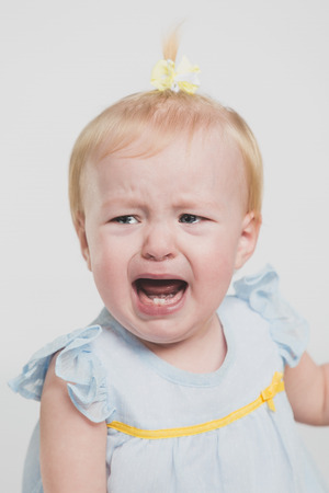 a young baby: One year old girl crying