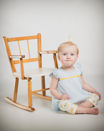 childs birthday party: One year old girl with rocking chair