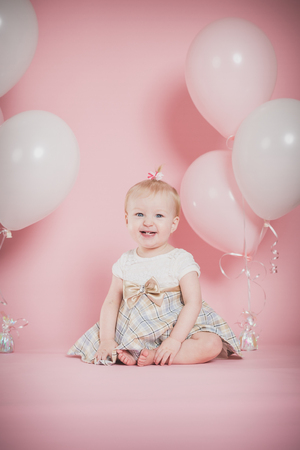 1 year old: One year old girl birthday portraits Stock Photo