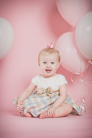 girl on a beautiful background: One year old girl birthday portraits with balloons