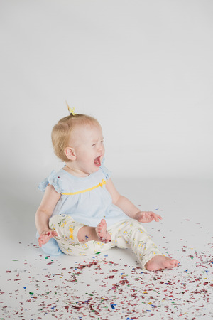one year: One year old girl with confetti