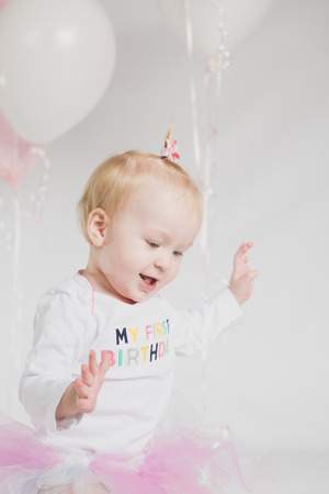 one year: One year old girl birthday portraits Stock Photo