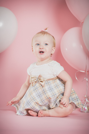 one year old: One year old girl birthday portraits Stock Photo