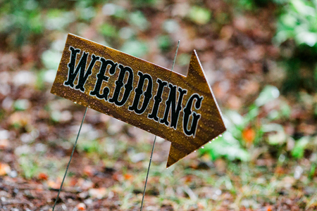 Rainy day wedding sign outside with raindrops