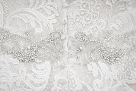 Cierre de encaje blanco vestido de novia y tela