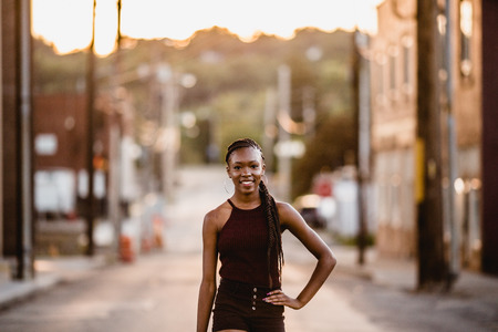 One African American girl poses for her senior portraits. Teen fashion. Teenage model. Stock Photo