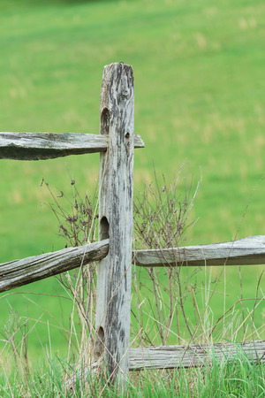 An old wooden weathered fence post in Pennsylvanian countryside