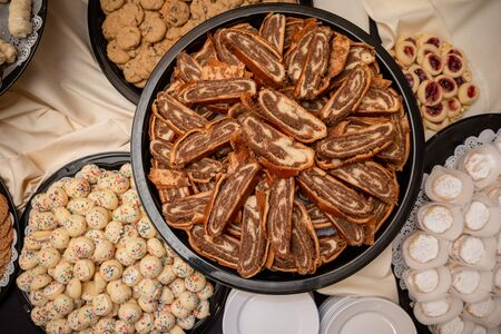 Sliced nut roll pastry on platter view from above Stock Photo