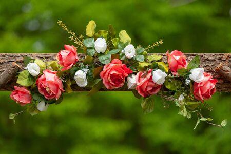 Artificial floral design detail outside wedding venue