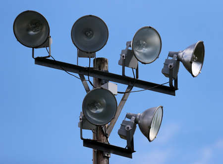 Ball field lights, lighting fixture in the daytime with blue sky Stock Photo