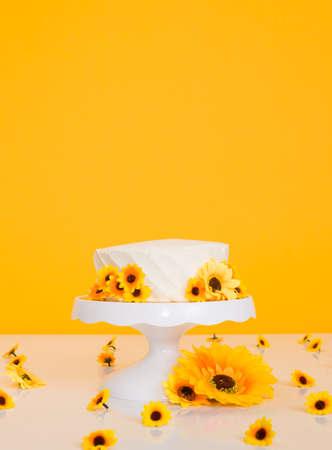 Cake smash setup with sunflower theme and bright vibrant yellow background