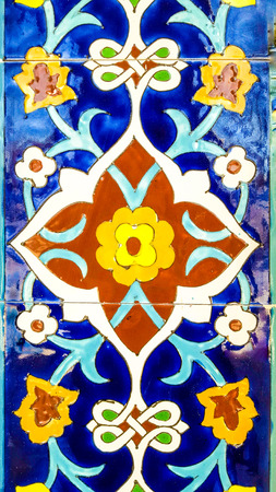 part of the tile from the wall of the mosque with a traditional floral Uzbek ornament