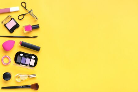 Set of professional decorative cosmetics, makeup tools and accessory of trendy pink color isolated on yellow background Flat lay Top view. Archivio Fotografico - 147890179