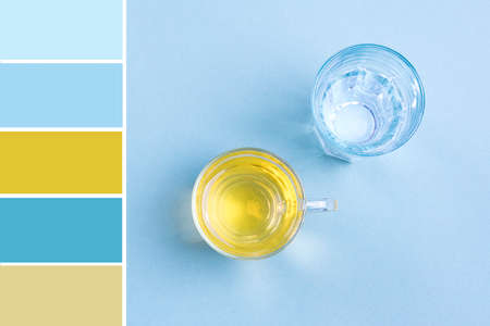 Pallete of colors Glass of water, cup of green tea on blue table Top view Flat lay Style life Beverages, drink and lose weight concept Harmonious combination of colors. Color theory and mixing. 免版税图像