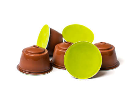 set of coffee capsules, roasted beans isolated on white background Top view Flat lay Drink obtained from dosed capsule with roasted, ground and compressed natural coffee. Stock fotó