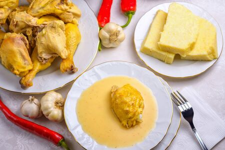 Caucasian cuisine. Circassian (Adyghe) traditional folk dish. Boiled chicken with sour cream sauce (djedlibje) Served with pasta (millet dish)
