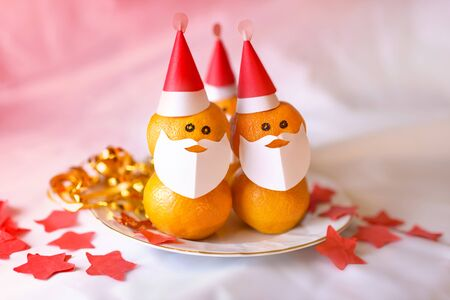 Christmas tangerines in the form of Santa Claus.