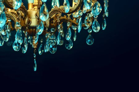 Crystal chandelier close-up. Cold reflections on the edges of the crystal. Dark background Zdjęcie Seryjne