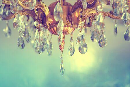 Crystal chandelier close-up. Gradient pastel background, sparkling background.