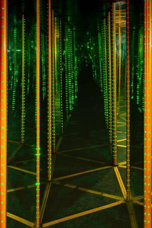 Abstract dark mirror maze with diode light. Entertaining children's attraction