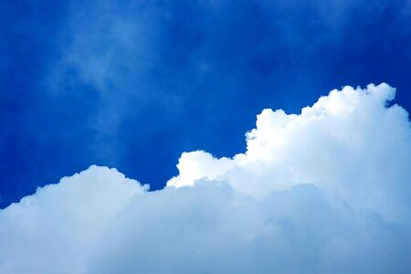 Clouds before the storm. Blue sky with huge clouds.