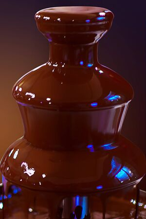Chocolate fountain fondue. Sweets and making desserts. Chocolate fountain on a dark gradient background