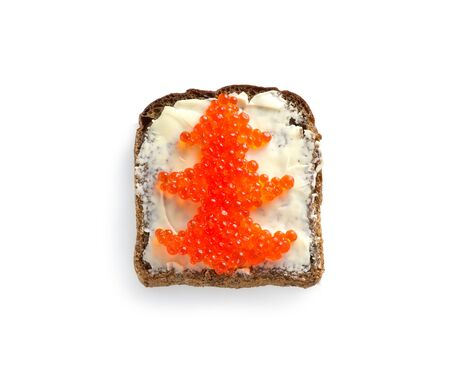 Red caviar on black bread in the form of a Christmas tree on a white background. Sandwich with caviar for the Christmas table