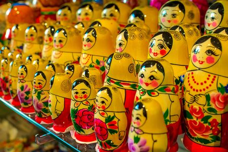 Souvenir dolls on the shelf for sale. Russian Matryoshka Nesting Dolls Set in Classic Clothes at Gift Shop Shelf. Souvenir from Russia.