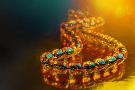 Ramadan Karim greeting background Islamic prayer bead, rosary. Rosary of amber.