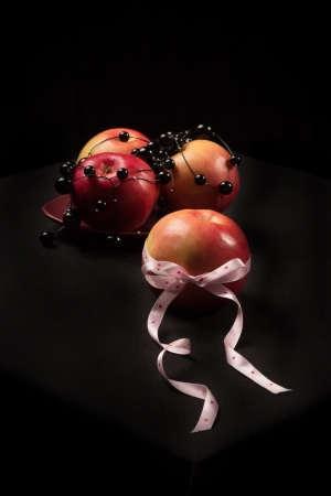 Beautiful apple tied with a ribbon with hearts photo