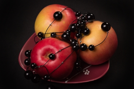 things that go together: Red apples on a black background in a photographic studio