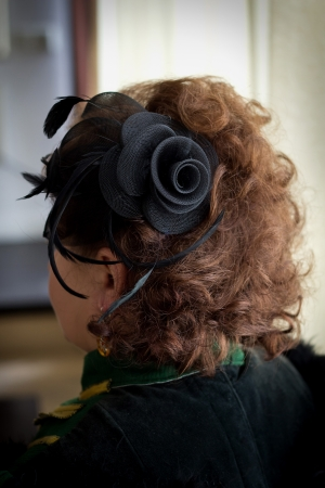 hairdress: Hairdress in ancient style, a curly hair and ornament in the form of a flower with pens
