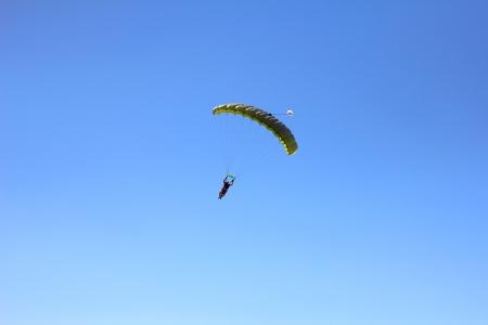 parachutists: Tandem parachutists parascending in Moldova Stock Photo