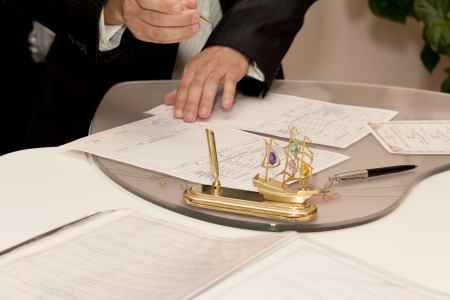 marriage certificate: Photo of groom signing the marriage certificate