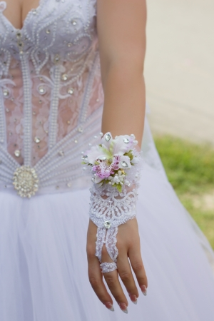 Romantic glove of the bride with a flower and jewels photo
